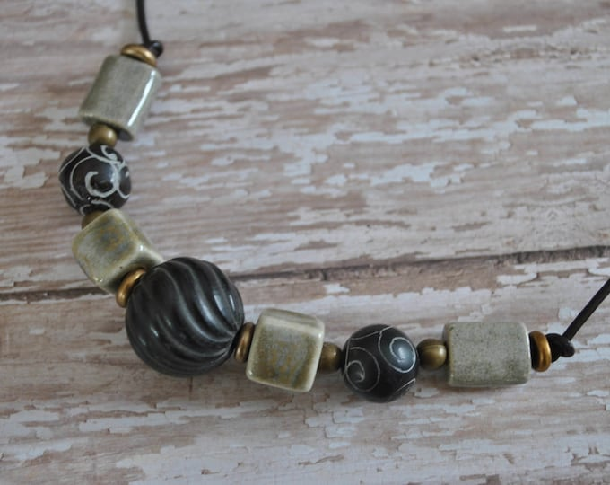 Men's Necklace of carved antiqued jade beads, ceramic beads, carved wooden focal bead on brown leather cord , masculine, rugged