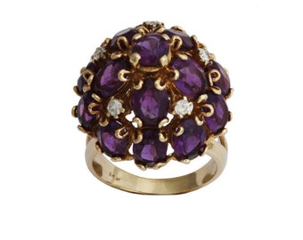 Vintage 14 karat yellow gold purple amethyst and diamond ring.