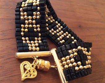 Czech glass beaded bracelet: black cubes. gold metal beads