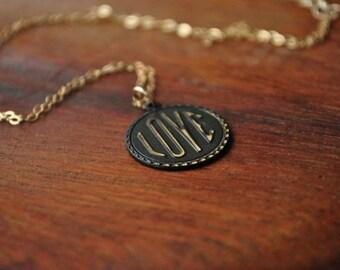 "Brass ""Love"" charm on 14k gold necklace"