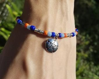 Beaded bracelet with sand dollar charm