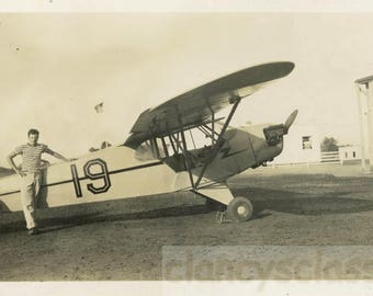 vintage photo 1950 Stripe Guy Stands by No.19 Bi Plane Airplane