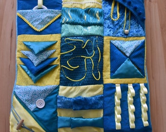 Sensory fidget lap blanket