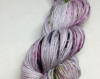 """Hand dyed yarn speckled in purples and greens.   A perfect yarn for your next project   Think """"fade"""", shawl, socks and more.              40"""