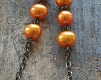 triple orange pearl earrings. freshwater pearls & oxidized sterling silver by val b.