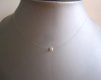 Nylon thread and zirconia necklace