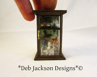 From *DJD* 12th scale populated macabre curio cabinet.