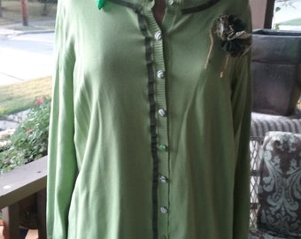 Green cardigan with handmade pin and covered buttons