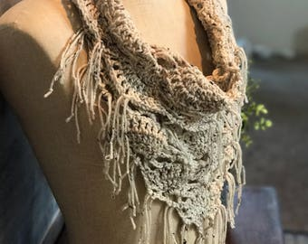"""Althea Scarf.  Infinity fringe scarf in """"oatmeal"""" color, earthy color off-white with earth toned flecks throughout scarf."""