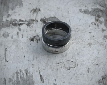DUALITY Hand-forged sterling silver statement ring scored with charge symbol