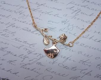 Gold bird on branch necklace