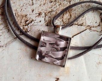 Chain Art in a pendant behind glass. Escher'