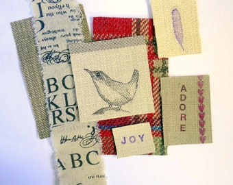 Small fabric patches / fabric scraps / art appliques. Textile, scrapbooking, junk journal supplies. Red & Neutrals. Bird, words, feather.