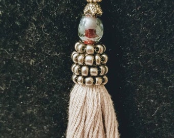 Unique wearable tassels made from new and vintage jewelry pieces. Upcycle or repurposed.
