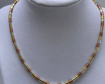 Vintage gold /copper/silver colored barrel beaded necklace