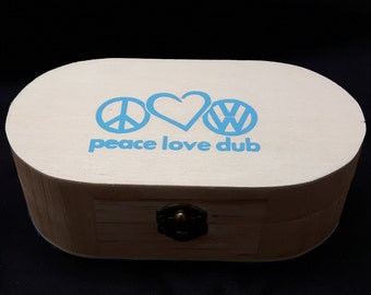 Wooden curved box with pale blue peace, love, dub decal on the top
