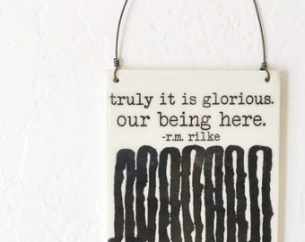 porcelain wall tile screenprinted text and river pattern truly it is glorious.  our being here. -r.m. rilke
