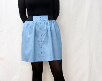 Rock, kurz und aus hellblauer Baumwolle mit elastischem Taillenbund