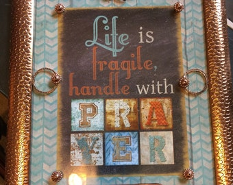 Life is Fragile, Handle with Prayer framed print, embellished with jewelry.