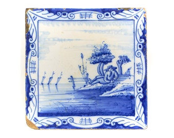 Antique 19th century Delft blue and white pottery tile.