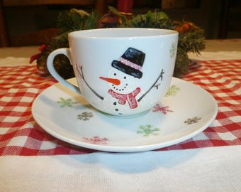 Cup and saucer porcelain painted snowman & snowflake