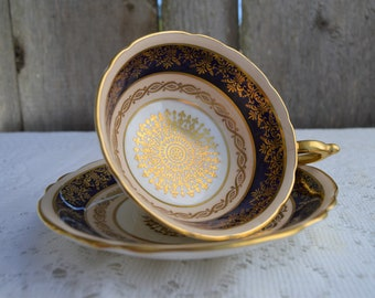 """Paragon Double """"By Appointment To HM The Queen and HM Queen Mary"""" Bone China Ivory Cobalt Teacup & Saucer Vintage 1940's Gold Design"""