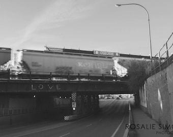 Black and White Photograph of Osborne Street, Winnipeg - Love graffiti on train bridge