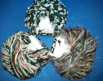 Multi-Strand Novelty Yarn by Ice Yarns, three skeins of Christmas yarn - green, red, gold