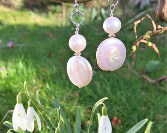 Coin shaped white freshwater pearls and potato pearls suspended from shepherd hooks and silver ring. Mother's Day Gift. Statement earrings