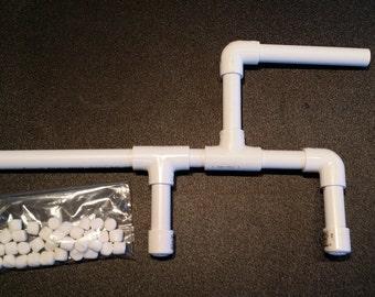 Mini Marshmallow shooter gun.