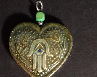 green hamsah heart pendant