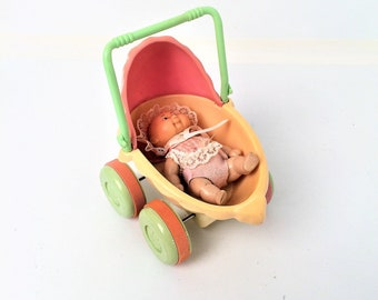 Cabbage patch Playmate 1985 mini carriage and doll