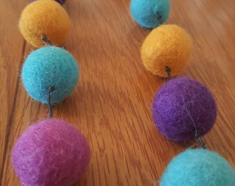 Felt ball necklace in purple orange and turquoise. Handmade necklace