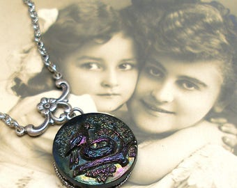 Mama BIRD BUTTON necklace, Victorian black glass with rainbow luster, on silver chain. 1800s button jewellery.