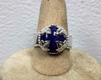 This ring is a size 8 with a 12 mm purple onyx agate stone.
