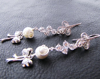 Long dangle bridal earrings with south sea shell pearls & silver bow on sterling silver ear hooks - Joy