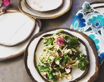 """Here's a peek of our new rustic """"Love"""" plates, salad plates, and votives."""
