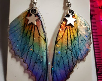 Rainbow wing earrings with iridescent colours and sparkles and a tiny star!