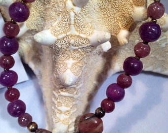 A Beaded Single Strand Bracelet of Genuine  Ruby Gemstone beads, and Iolite Briolette Focal in Sterling Silver.