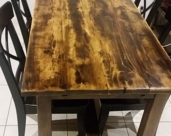 Solid pine dining table with a rustic finish