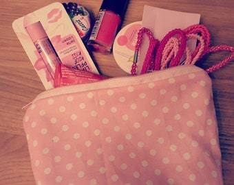 Cosmetic pouch in pink with white dots