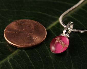 Sterling Silver Miniature Pressed Snow White Flowers Oval Pink Pendant