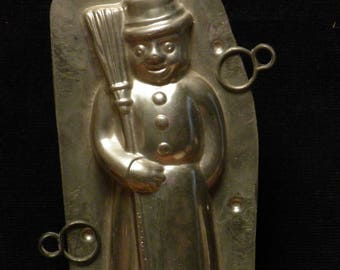 Antique Christmas  two part chocolate mold of a sweet snowman with broom