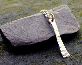 Silver bar pendant with gold hoop