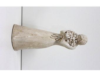 A Girl Holding  Flowers Sculpture