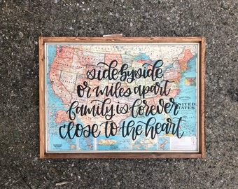 Side by side or miles apart Wood Map Sign