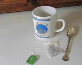 Toronto, Canada Souvenir Mug – Blue and Gold Toronto Skyline on White Ceramic Mug – Vintage 8 ounce Souvenir Coffee Cup – Galaxy Mug