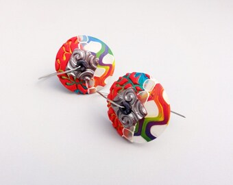 Red and multicolored disk earrings with new design and wire fabrication by Marie Segal
