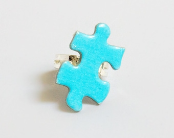 Adjustable blue puzzle ring