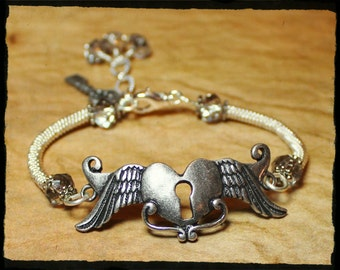 Winged Heart... Handmade Jewelry Bracelet Beaded Key Lock Crystal Wirework Wire Wrapped Metal Bangle Cuff Silver Gray Steampunk Adjustable